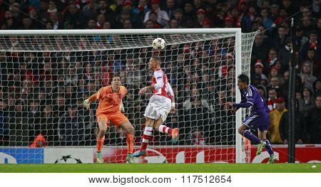LONDON, ENGLAND - NOV 04 2014: Arsenal's Kieran Gibbs makes a defensive header during the UEFA Champions League match between Arsenal from England and Anderlecht from Belgium