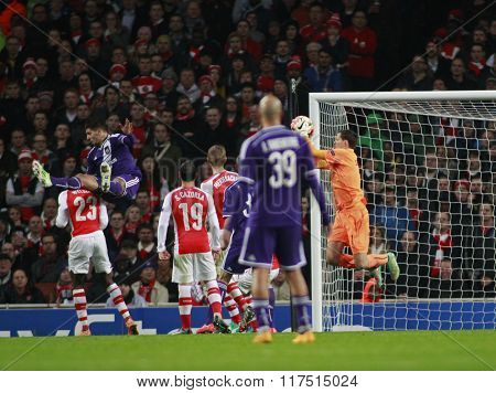 LONDON, ENGLAND - NOV 04 2014: Arsenal's Wojciech Szczesny makes a save as Aleksandar Mitrovic of Anderlecht fouls Danny Welbeck during the UEFA Champions League match between Arsenal and Anderlecht