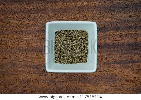 Ground Black Pepper In White Bowl