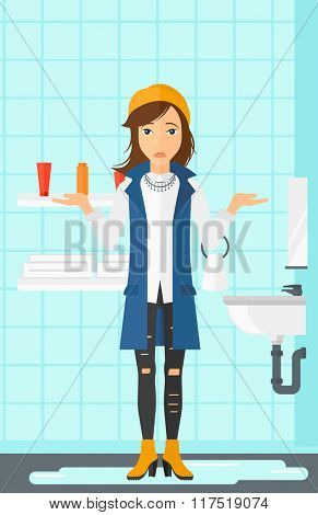 Woman in despair standing near leaking sink.