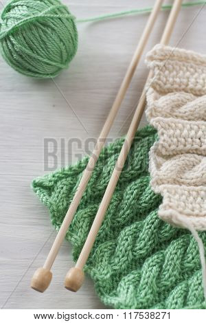 Two Bright Patterns And Wooden Knitting Needles For A White Background