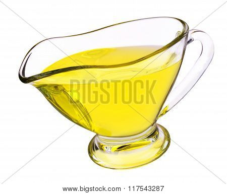 Glass gravy boat with oil