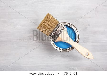Paintbrush and can with paint. Top view.