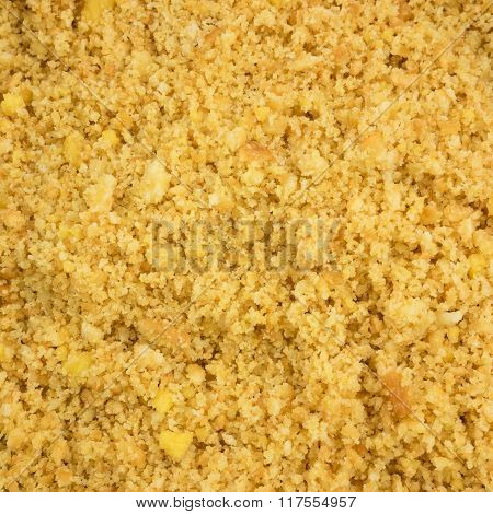 The close up of graham cracker crust mix with melted butter
