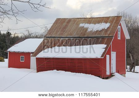 Corn crib in winter covered by snow