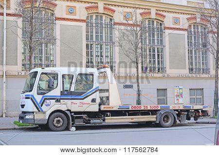 Paris, France, February 7 , 2016: wrecker on a parking in Paris, France