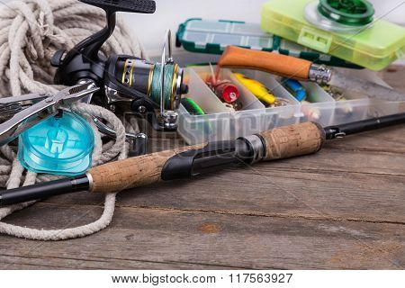Fishing Tackles And Baits In Storage Boxes