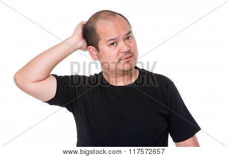 Man scratching his head