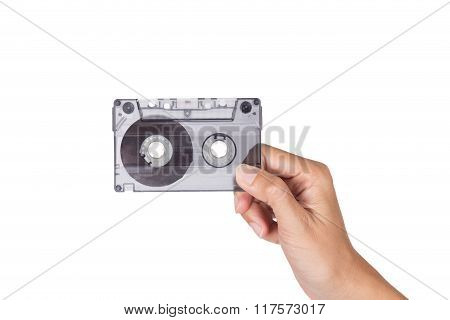 Hand Holding Old Cassette Tape Isolated On White Background
