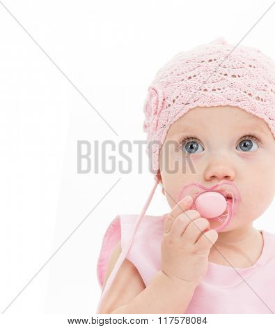 little child baby girl portrait 1 year pink dress hat baby's dummy soother isolated on white studio shot