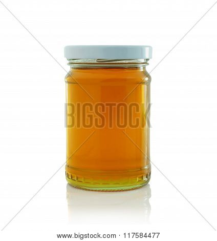 the honey bottle on the white background