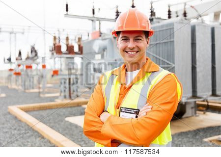 handsome electrical engineer arms crossed in substation
