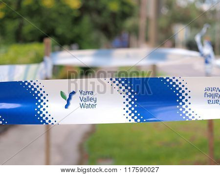 Safety Tape Of  The Yarra Valley Water Authority At A Mains Water Leakage