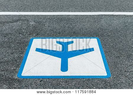 sign painted on asphalt road for airport shuttle bus