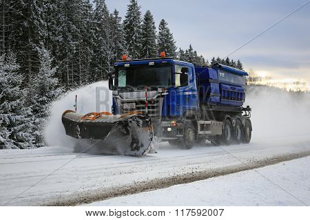 Scania Truck Equipped With Snowplow Clears Highway