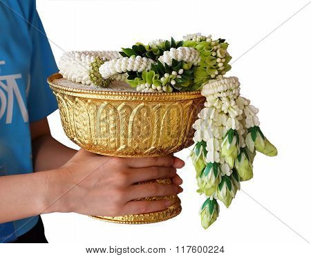 people holding the wreath of the flower on the golden pedestal.use for offer honarable people in thai culture