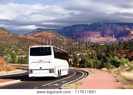 White tourists bus cornering in Sedona.