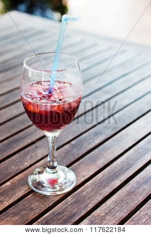 Glass Half-full Glass Of Sangria And Ice.