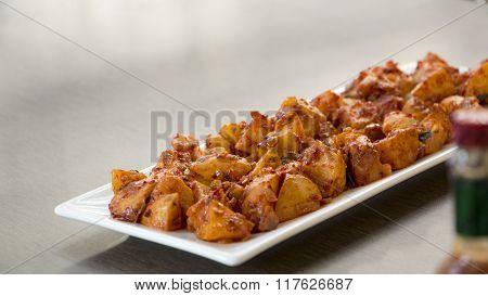 Batata Saung Or Konkani Style Potatoes In A Chilli Tamarind Sauce.