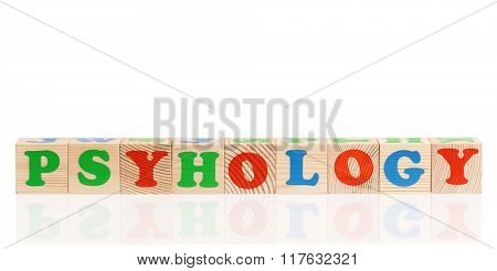 Psyhology word formed by colorful wooden alphabet blocks, isolated on white background