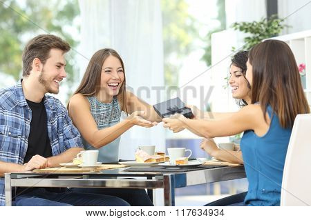 Friends Celebrating Birthday And Giving Gift