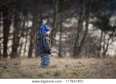 Little Boy Playing Outdoor Near Forest