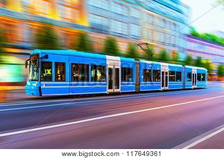 Modern tram on city street in Stockholm, Sweden