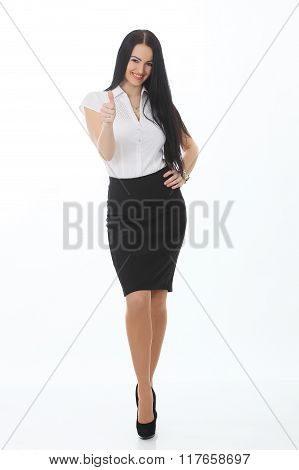 Full Length Portrait Of A Cheerful Businesswoman Pointing Finger Away Camera. Isolated On A White Ba
