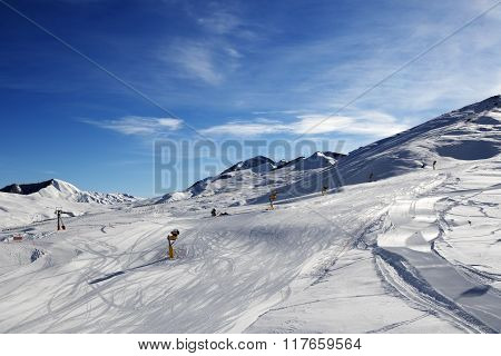 Ski Slope With Snowmaking At Sun Morning