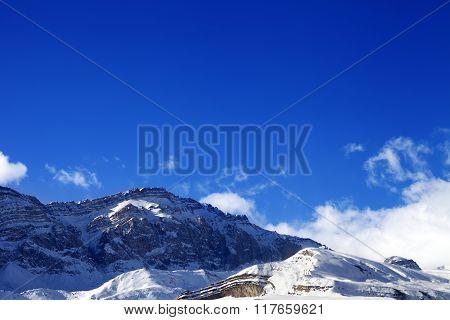 Snowy Rocks At Sun Day