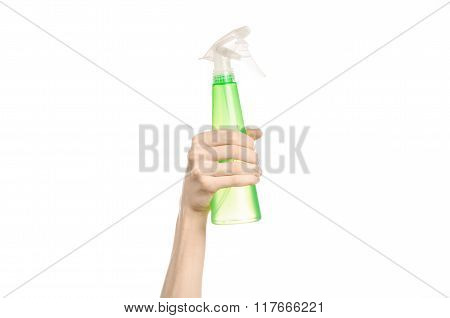 Cleaning The House And Cleaner Theme: Man's Hand Holding A Green Spray Bottle For Cleaning Isolated