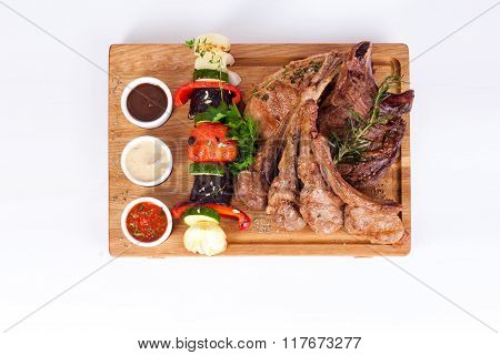 ribs with rosemary and vegetable barbecue grill, sauces  wooden board isolated white background menu