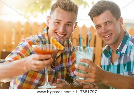 Two men resting at caffe