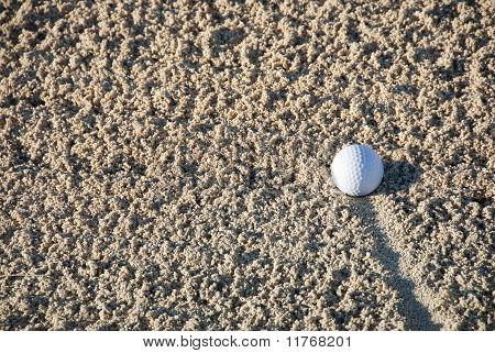 Golf Ball in a Sand Trap