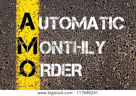 Concept image of Business Acronym AMO Automatic Monthly Order written over road marking yellow paint line poster