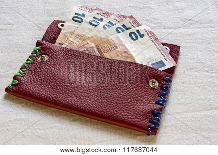 Ten Euro Notes In An Open Purse