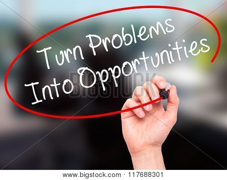 Man Hand Writing Turn Problems Into Opportunities With Black Marker On Visual Screen.