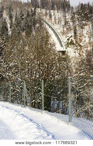 Steep Cable Railway Tracks Up Snowy Mountain