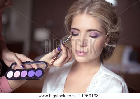 Beautiful Bride Wedding With Makeup And Hairstyle. Stylist Makes Make-up Bride On Wedding Day. Portr