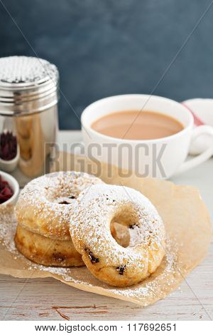 Vanilla baked donuts with dried cranberries dusted with powdered sugar poster