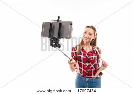 Happy Young Pretty Girl Making Photo With Selfie Stick
