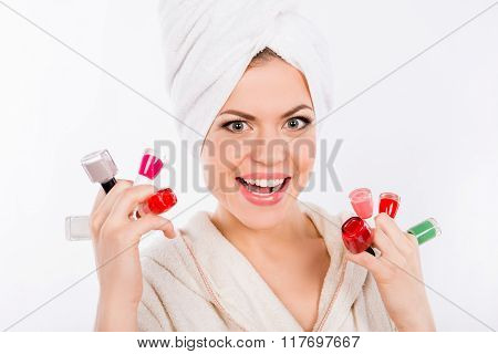 Close-up Portrait Of A Happy Toyng Girl With Nail Laquers