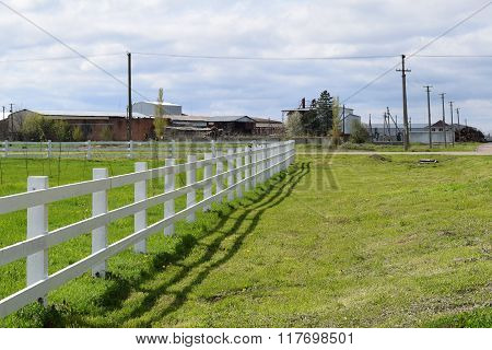 White wooden fence around the ranch. Wooden fence in the village. poster
