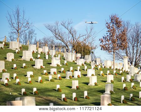 WASHINGTON DC USA - DECEMBER 26 2014: A Commercial Flight flying over the Arlington cemetery near to land in Ronald Reagan airport.