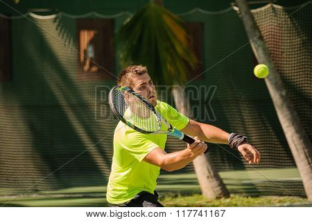 Man Plays Tennis In Bright Cloth