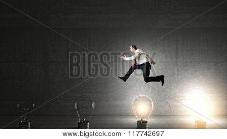 man jump over 3d bulb concept of idea