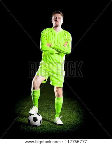 football player in green uniform on grass field.