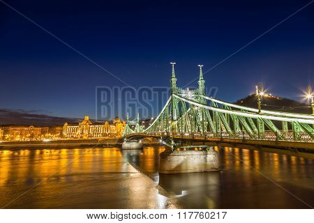 Nightshot at chain bridge on Danube river with lights, Budapest city Hungary.