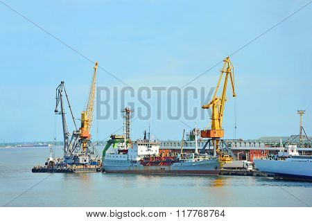 Pump-dredge Ship Under Port Crane