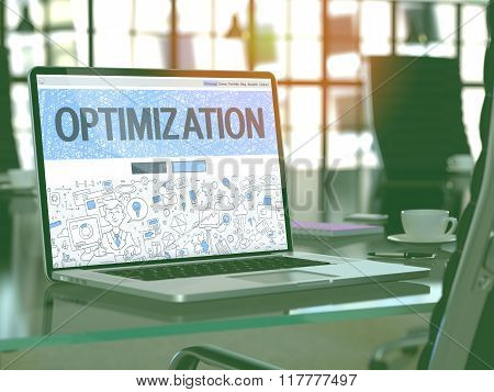 Optimization on Laptop in Modern Workplace Background.